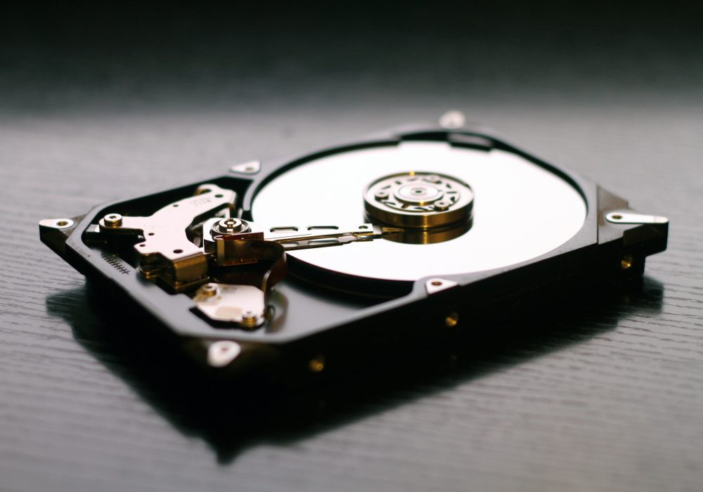 Opened hard drive, showing internal components